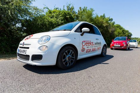 white and red Fiat 500's with Geeks On Wheels branding
